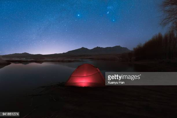 tent under the stars on the lake - base camp stock pictures, royalty-free photos & images