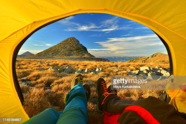 tent view of couple resting in their camping tent in autumn mountains - bansko stock pictures, royalty-free photos & images