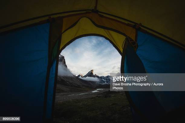 tent view of mount thor on baffin island - baffin island stock pictures, royalty-free photos & images