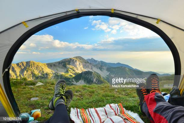 tent view of mountain range with hiking boot in the foreground - pirin mountains stock pictures, royalty-free photos & images