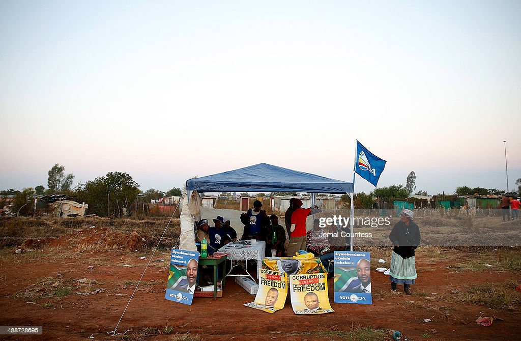 A tent with representatives of the Democratic Alliance is seen adjacent to the township of Bekkersdaal at the voting station at Bekkersdaal during the 2014 South African General Election on May 7, 2014 in the Bekkersdaal Township in Gauteng province of South Africa. Polls have opened in South Africa's fifth general election since the end of apartheid over 20 years ago. President Jacob Zuma is expected to return to power with the ANC party however his election campaign has been marred by allegations of corruption and he is expected to lose some ground to other parties.