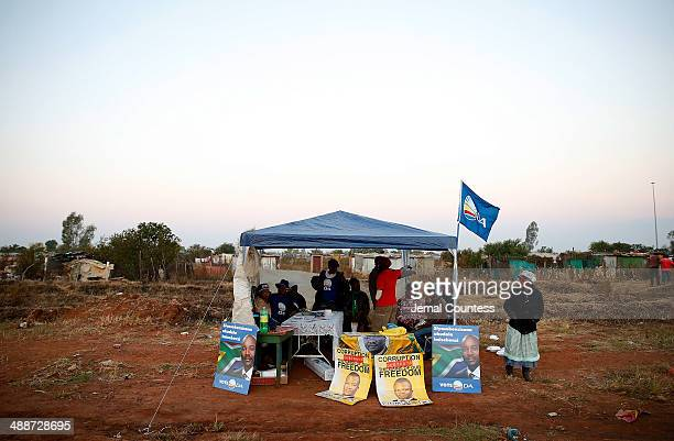 A tent with representatives of the Democratic Alliance is seen adjacent to the township of Bekkersdaal at the voting station at Bekkersdaal during...