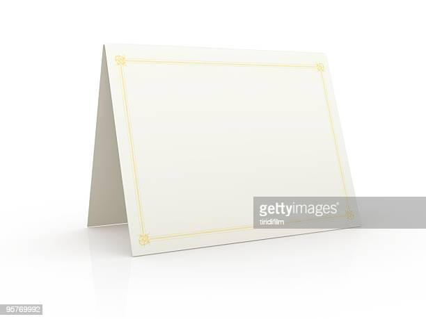 Tented blank white card on a white surface
