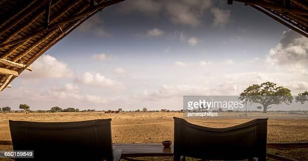 A tented cabin overlooking watering hole, Tsavo West, Kenya