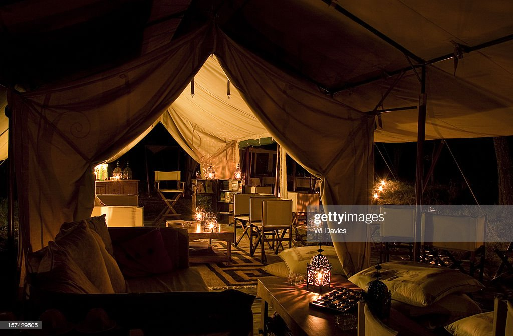 Tented safari camp by night : Stock Photo