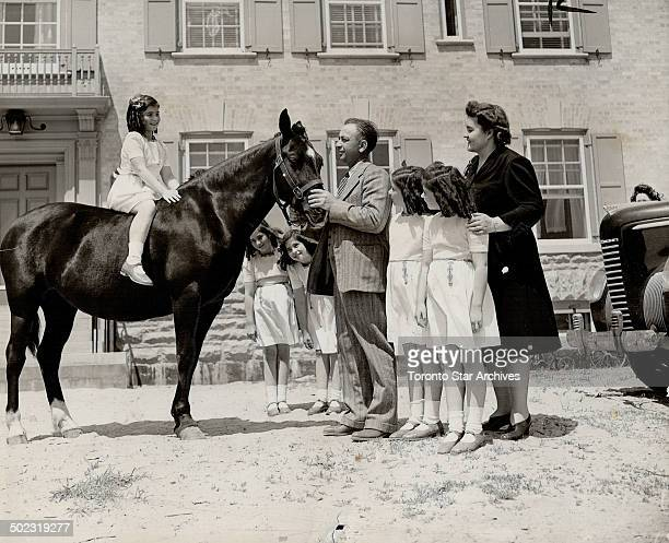 Tenth birthday gift for the Dionne quintuplets was this pony presented to them by their father The quints celebrating their anniversary in their new...
