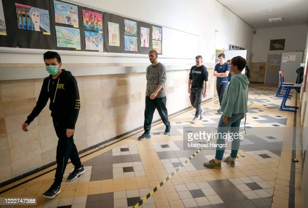 Tenth graders who will soon face exams train social distancing rules in the school building at the Schillerschule school during the novel coronavirus...