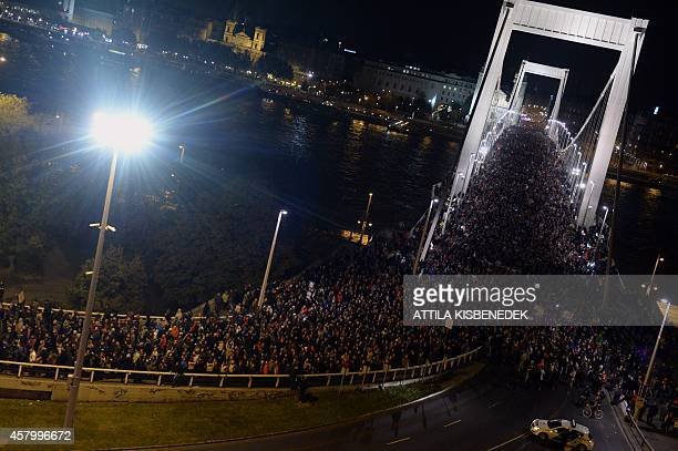 Tenthousand participants march accross the Elisabeth bridge during an antigovernment rally against the goverment's new tax plan for the introduction...