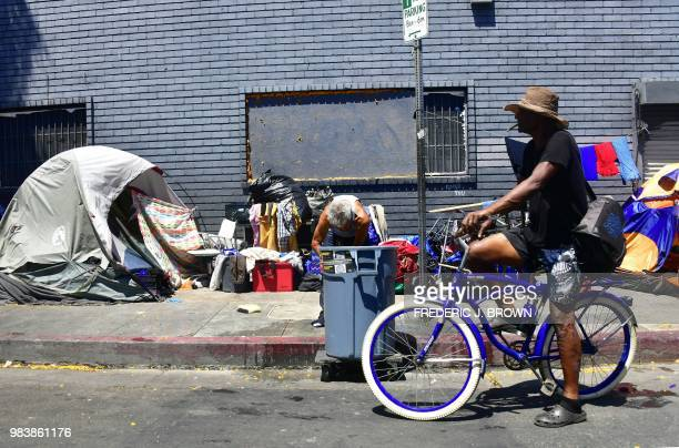 Tents and belongings of the homeless line a street in downtown Los Angeles California on June 25 as a United Nations report on poverty and inequality...