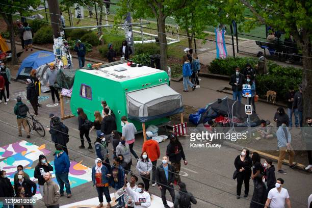 Tents and campers are set up in an area dubbed the Capitol Hill Autonomous Zone on June 12, 2020 in Seattle, Washington. The area had been the site...