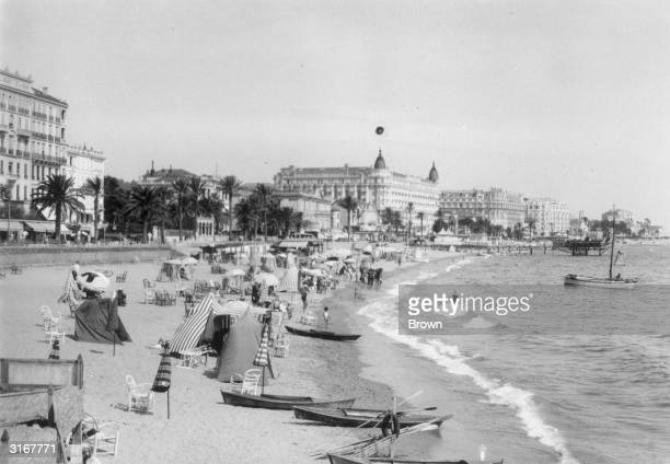 Tents and windbreaks on the beach with a choppy sea at Cannes in southern France