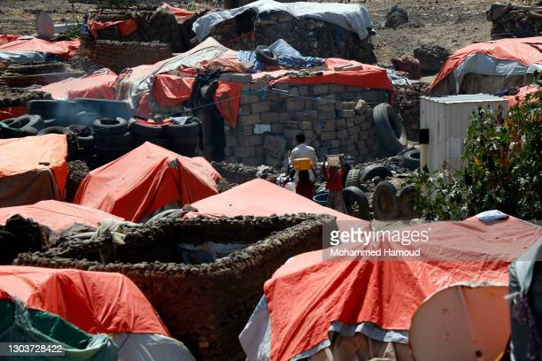 Tents are built at an internally displaced camp on February 21, 2021 on the outskirts of Sanaa, in Yemen. According to the United Nations, the war...