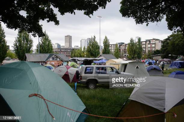 Tents are pictured in Cal Anderson Park in an area being called the Capitol Hill Autonomous Zone located on streets reopened to pedestrians after the...