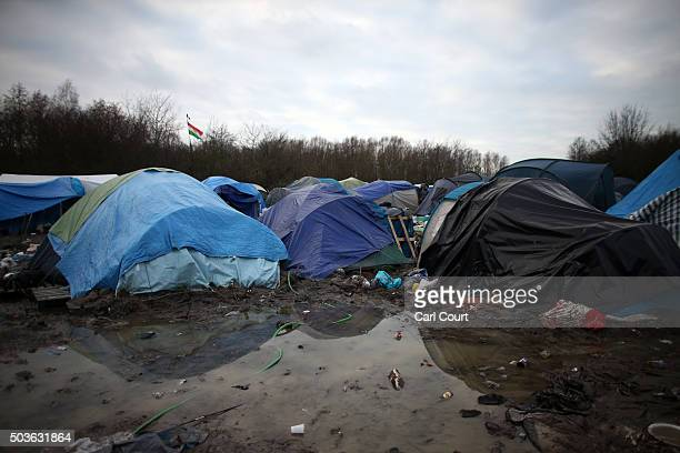 Tents are pitched in mud and water in a new migrant camp on January 6 2016 in Dunkirk France Thousands of migrants continue to live in makeshift...