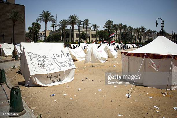 CONTENT] Tents are pitched on Tahrir square as part of a sitin in support of the Tamarod campaign to oust the Egyptian president Mohammed Morsi...