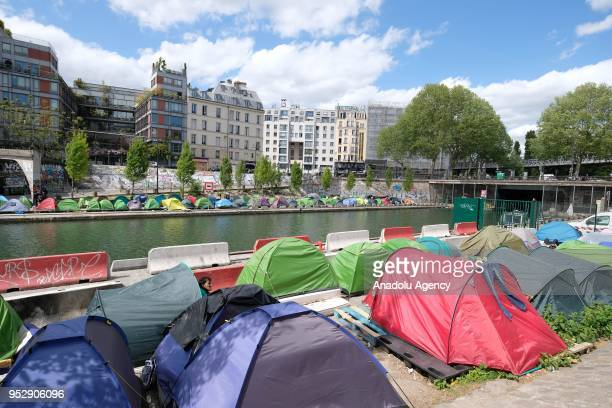 Tents are seen at a makeshift refugee camp around the Canal SaintMartin in Paris France on April 30 2018