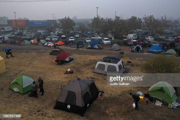 Tents are seen pitched in a field next to a Walmart parking lot where Camp Fire evacuees have been staying on November 16 2018 in Chico California...