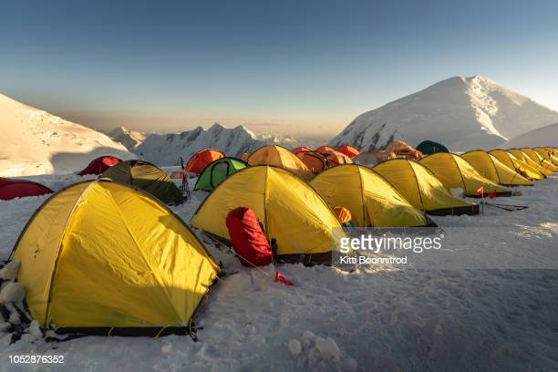 Tents at camp 3 of Lenin peak at sunrise, Kyrgyzstan