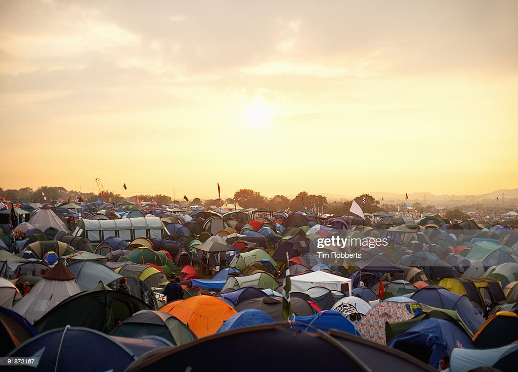 Tents at sunset at Glastonbury music festival : Stock Photo
