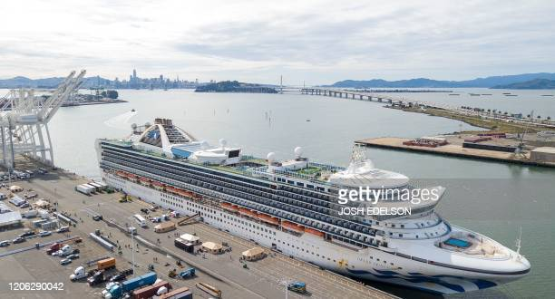 Tents begin to appear as workers tend to passengers disembarkingf from the Grand Princess cruise ship at the Port of Oakland in California on March...
