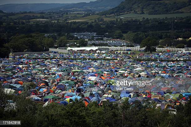 Tents begin to fill the fields at the Glastonbury Festival of Contemporary Performing Arts site at Worthy Farm Pilton on June 26 2013 near...
