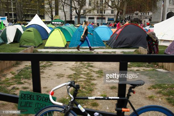 Tents belonging to members and supporters of climate change activist group Extinction Rebellion cover grass near Marble Arch in London England on...