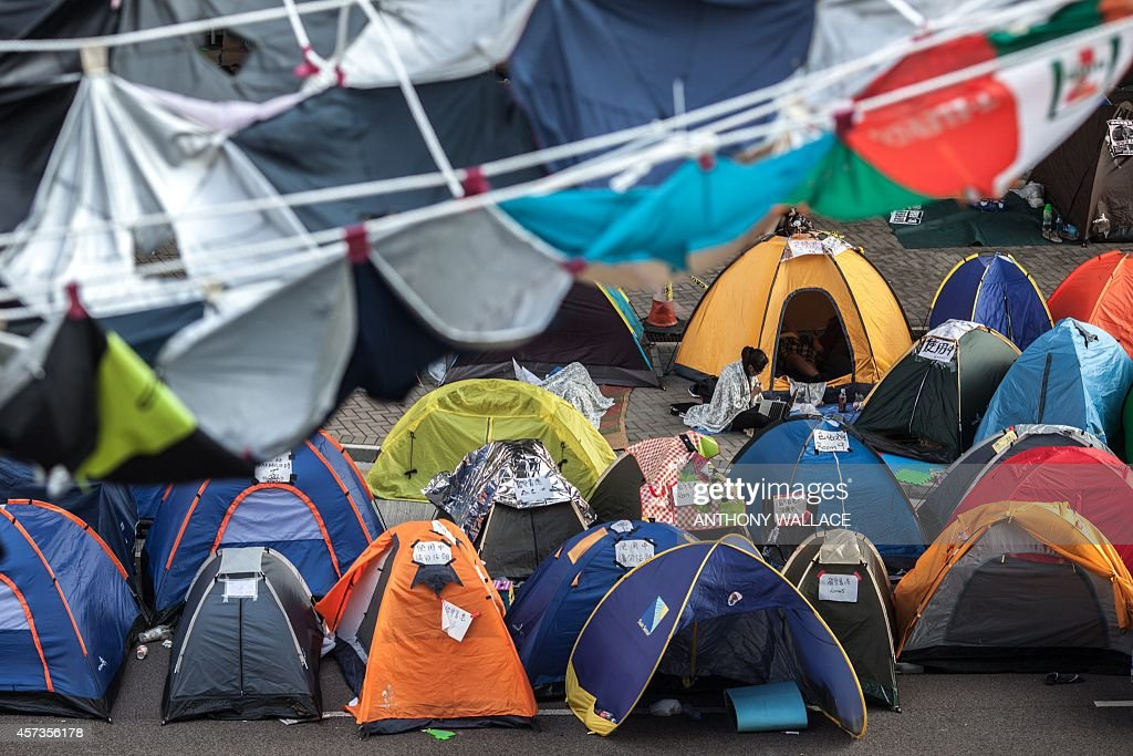 Tents belonging to members of the Occupy movement are pitched upon a flyover blocked by protestor & Wallace Tent Stock Photos and Pictures | Getty Images