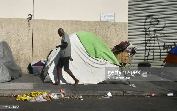 Tents house the homeless on a street November 10 2017 in Los Angeles California home to one of the nation's largest homeless populations and where...