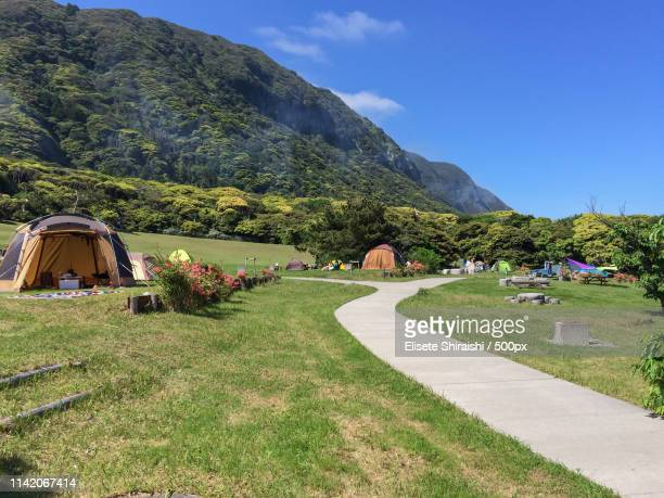 tents in mountain landscape - アウトドア ストックフォトと画像