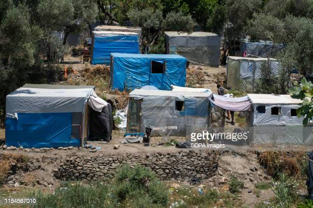 Tents in the hillside surrounding the Samos. The tented area is locally known as the Jungle. Samos Island is one of Europes migrant hotspots acting...