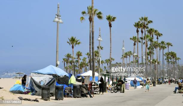 Tents line the Ocean Front Walk on June 30, 2021 in Venice, California, where an initiative began this week offering people in homeless encampments a...