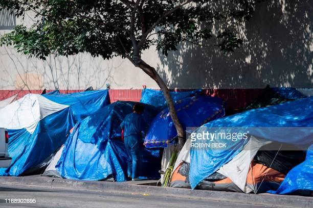 Tents line the street in Skid Row in Los Angeles California on September 17 2019 US President Donald Trump has indicated he plans to address the...