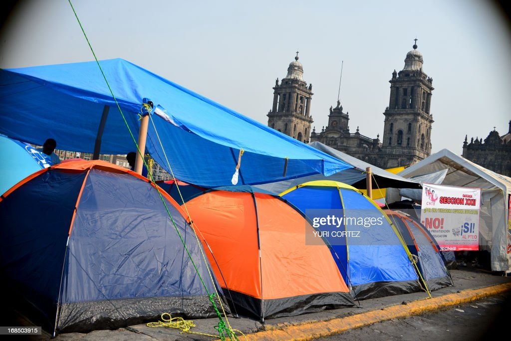 Tents of teachers members of the National Coordinating Committee of Education Workers (CNTE), are set up in front of the National Palace in Mexico City on May 10, 2013. The teachers protest against the educational reform proposed by the Mexican government. AFP PHOTO/ Yuri CORTEZ