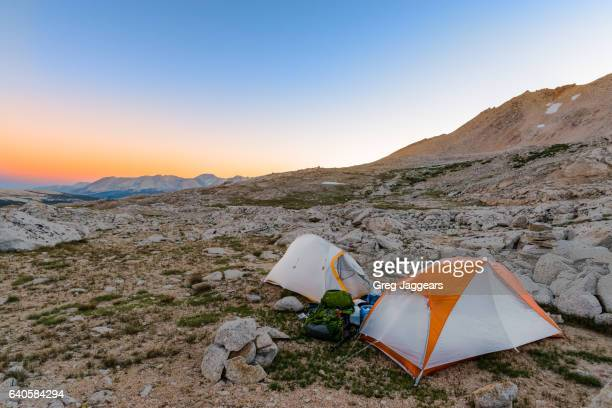 tents on rocky terrain, california sierra nevada - john muir trail stock photos and pictures