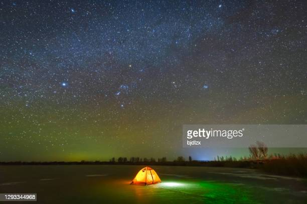 tents on the ice under the galactic sky - geminid meteor shower stock pictures, royalty-free photos & images
