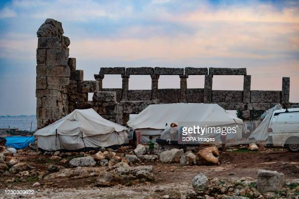 Tents seen set up at the Dana ancient site. A group of displaced Syrians reside inside ancient buildings dating back to the ancient Roman and...