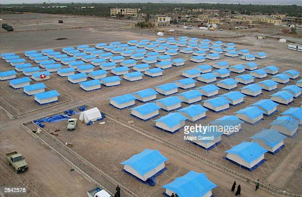 Tents set up by relief workers stand ready for Iranians who lost their homes in last week's earthquake in this aerial view January 3 2004 in Bam Iran...