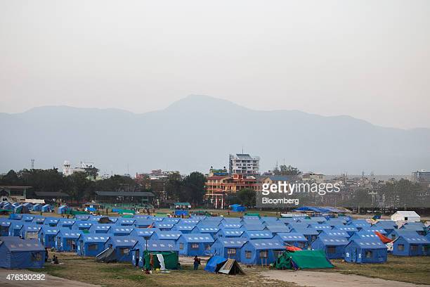 Tents stand at an internal displacement camp at the Tudikhel field in Kathamandu Nepal on Wednesday June 3 2015 Nepal's gross domestic product will...