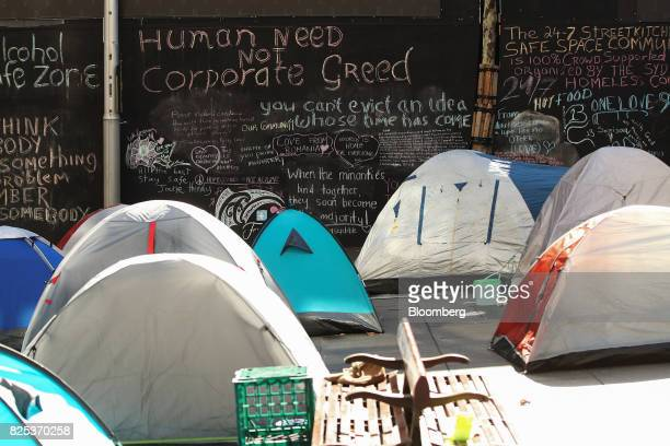 Tents stand in front of a chalkboard wall at a camp for the homeless at Martin Place in Sydney Australia on Thursday Aug 1 2017 On the doorstep of...