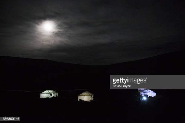 Tents used by Tibetan nomads picking cordycep fungus are seen on the night of the full moon on May 21 2016 on the Tibetan Plateau near Yushu town in...
