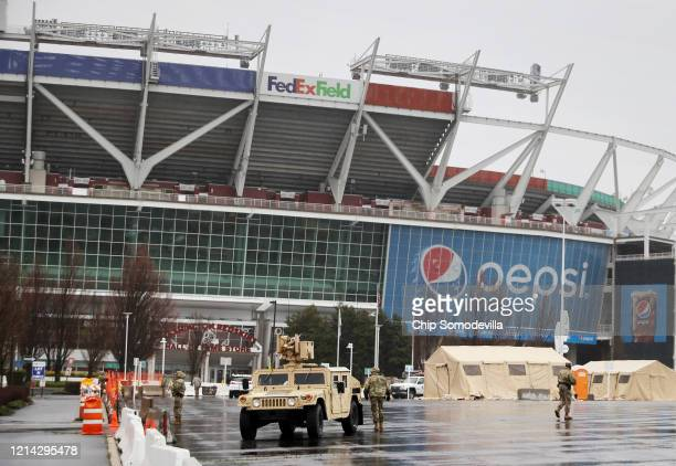 Tents, vehicles and other equipment from the Maryland National Guard occupy a section of parking lot on the south side of FedEX Field that officials...