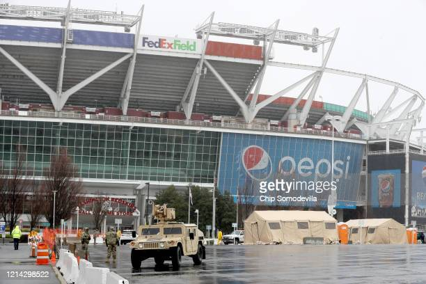Tents vehicles and other equipment from the Maryland National Guard occupy a section of parking lot on the south side of FedEX Field that officials...