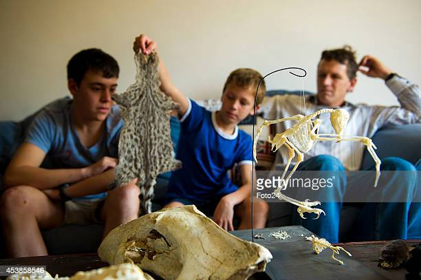 Tenyearold Francois Malherbe and his father Donnie during an interview on August 13 2014 in Cape Town South Africa Malherbe and his father collect...