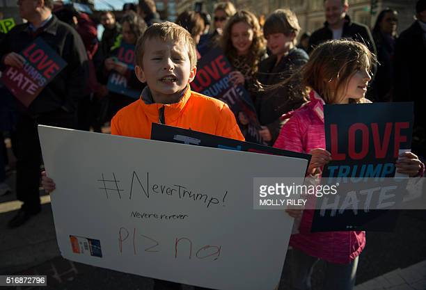 Tenyearold Henry and sevenyearold Ruby both who were not allowed to give their last names protest outside Verizon Center where Republican presidentil...
