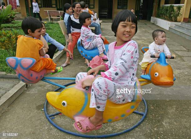 Ten-year-old HIV positive Nguyen Thi Thuy plays with other children at a kindergarten in the Centre for Social Protection No. 2, some 80 kilometres...