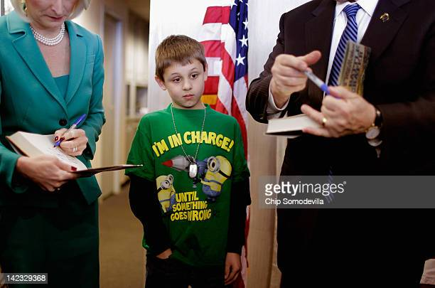Tenyearold James McKane of Frederick watches as Republican presidential candidate former House Speaker Newt Gingrich and his wife Callista Gingrich...
