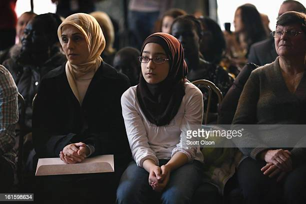 Tenyearold Kiana Mohammadian who is from Canada participates in a citizenship ceremony at the Chicago Cultural Center on February 12 2013 in Chicago...