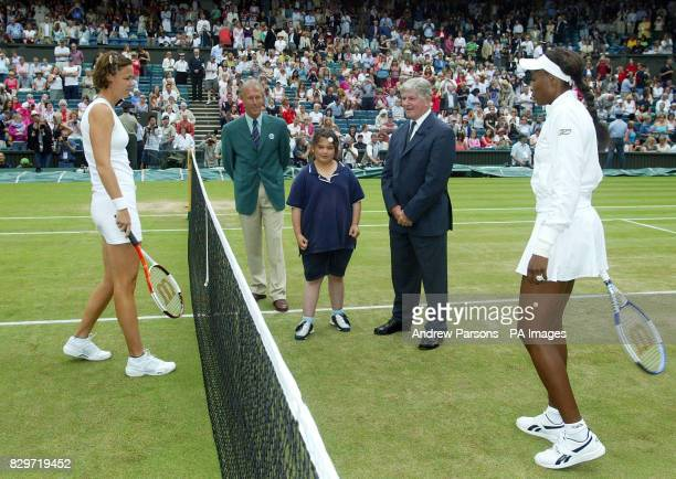 Tenyearold Laila Shenair from Manor Park in east London representing the charity 'Community Links' performs the coin toss as USA's Lindsay Davenport...