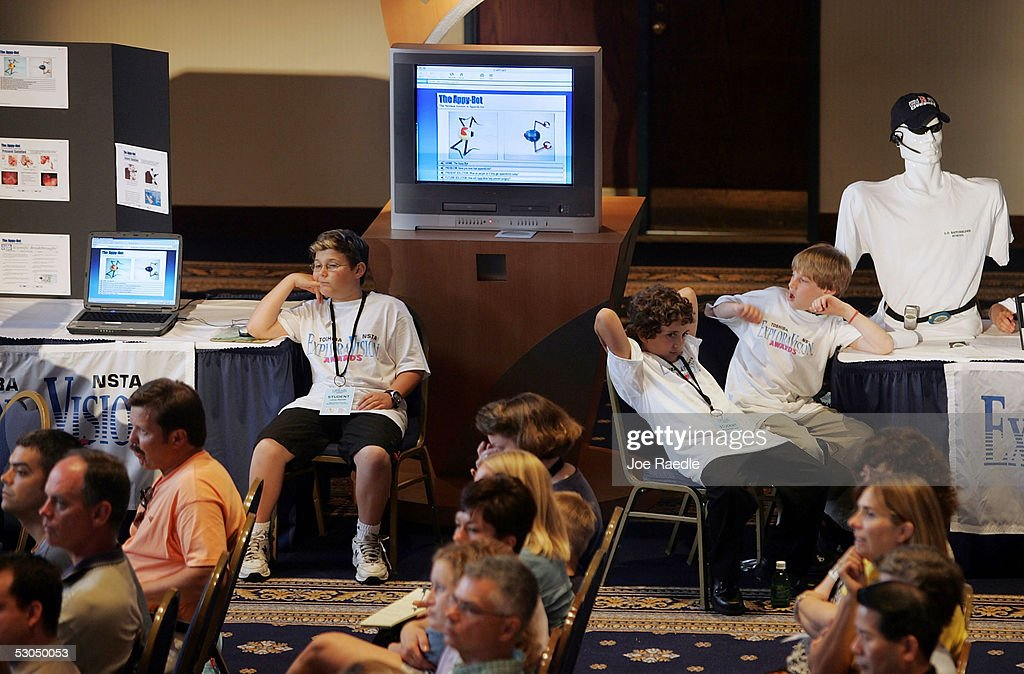 Ten-year-old Lenny Ranallo, of Heritage Heights Elementary School, and nine-year-olds Michael Dell Isola and Sam Sutera, of L.D. Batchelder School, wait their turns to present their technological inventions during the Toshiba NSTA ElxploraVision Awards luncheon June 10, 2005 in Washington, DC. The awards competition is one of the worlds largest K-12 science and technology competitions in which teams of students envision technologies that could exist 20 years in the future.
