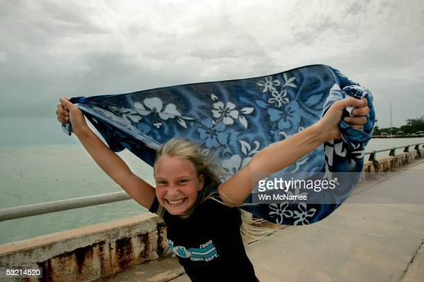 Tenyearold Quinn Beynard uses a towel as a makeshift kite to catch the growing winds generated by the approaching Hurricane Dennis July 8 2005 in Key...